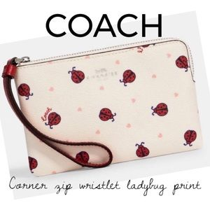 NWT COACH corner zip wristlet ladybug print